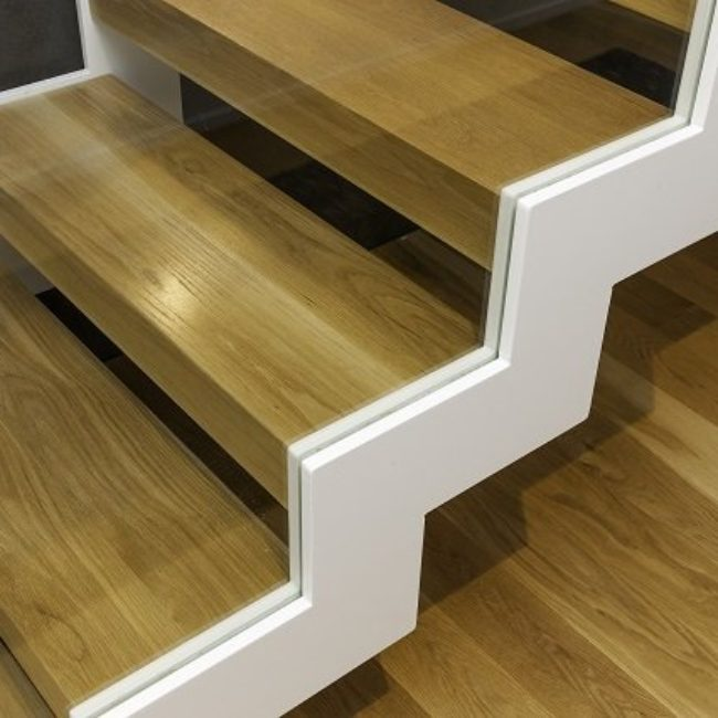 Zig Zag stringers in metal with glass balustrade